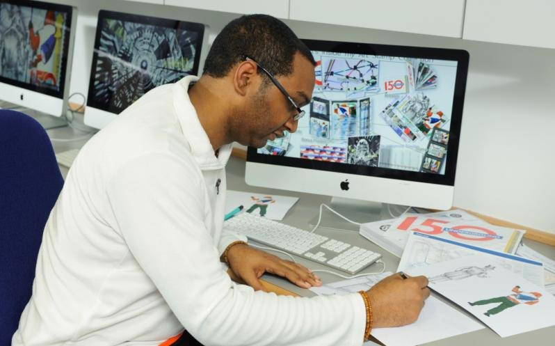 WAES student Glen works on his designs in one of the Mac Suites at Lisson Grove