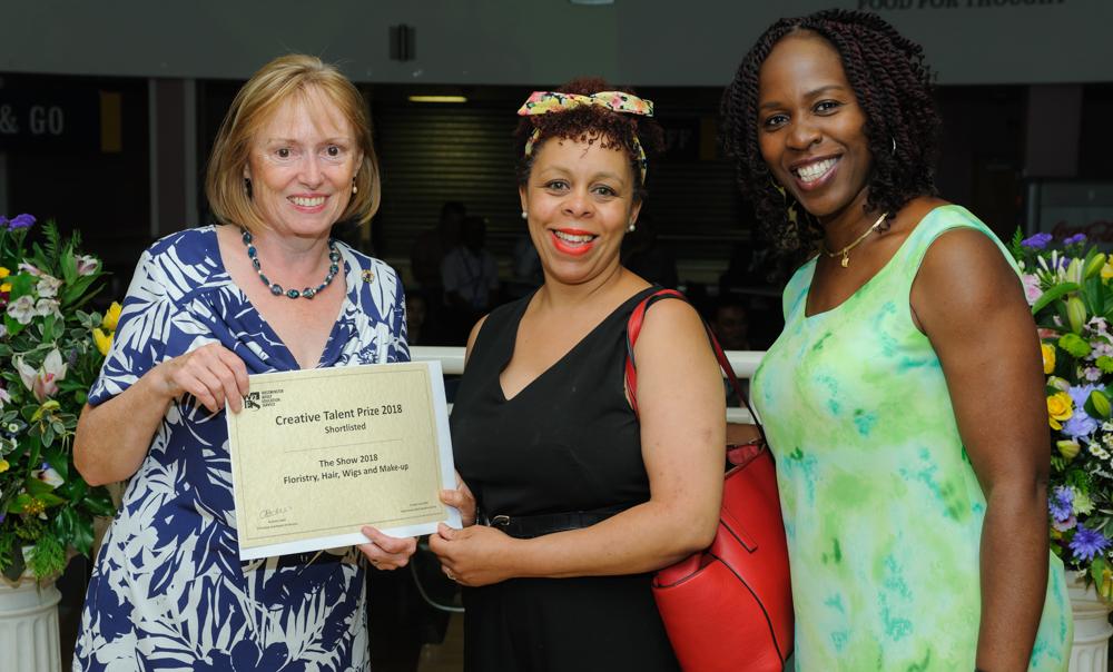 Cllr Jacqui Wilkinson (l) presenting learner Sonia Edwards (c) with Principal Arinola Edeh (r)