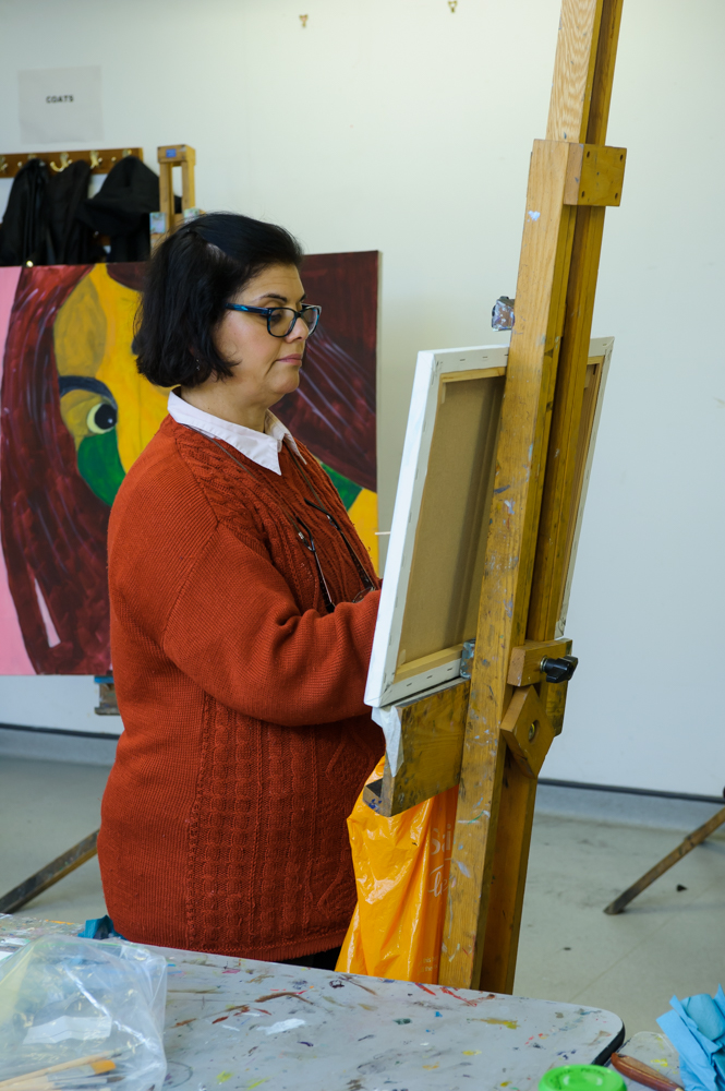 Learner painting in a WAES class